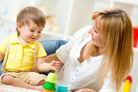 sittercity-woman-building-blocks-with-child